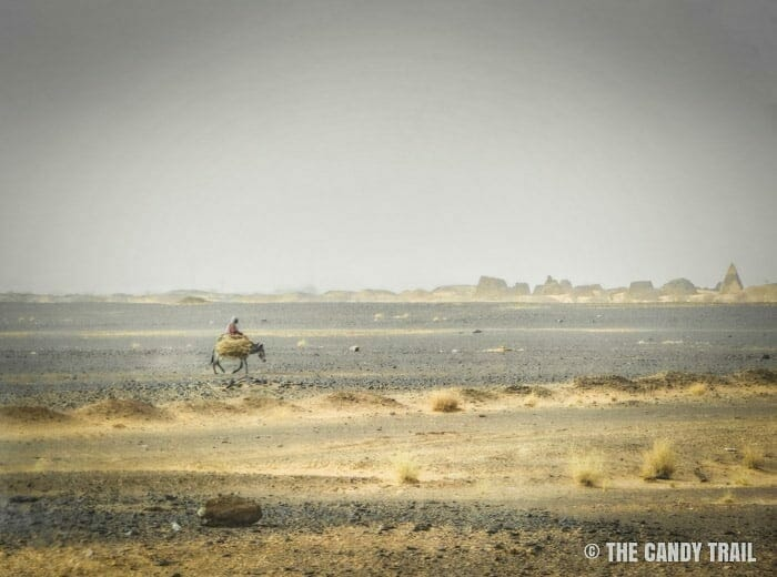man-on-donkey-near-meroe-pyramids-sudan