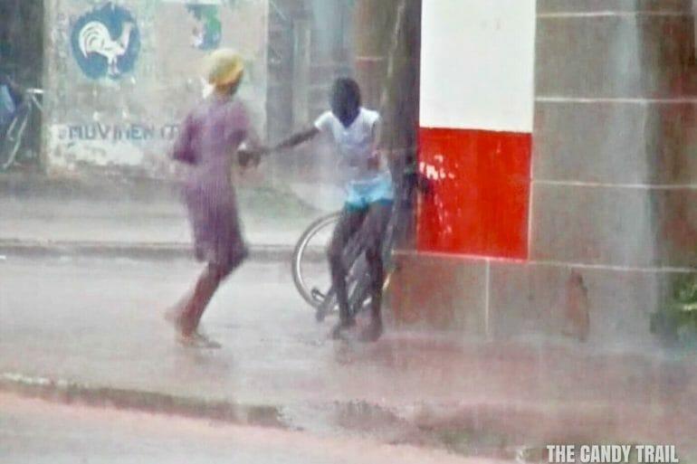 girls happy street shower guinea bissau video