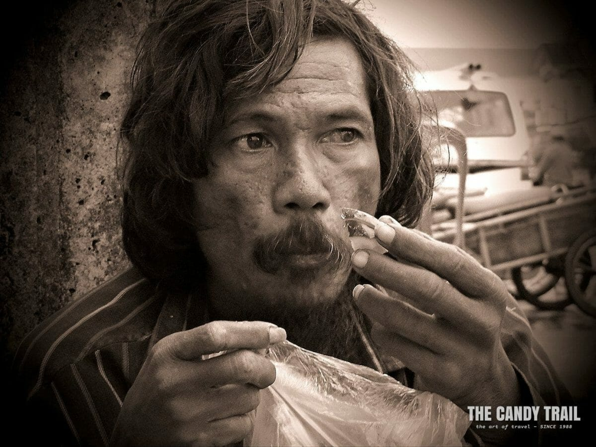 crazy street guy gets a meal Cambodia video