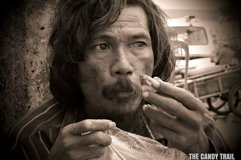 crazy street guy eating-meal cambodia video