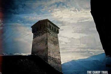 ancient-stone-tower-against sky-mestia-georgia