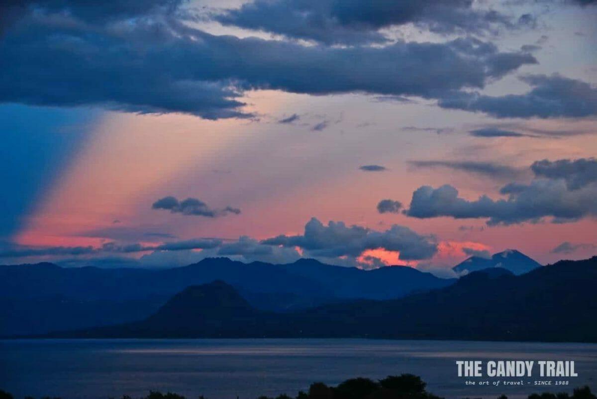 awesome sunset over vlocanoes at Lake Atitlan in Guatemala