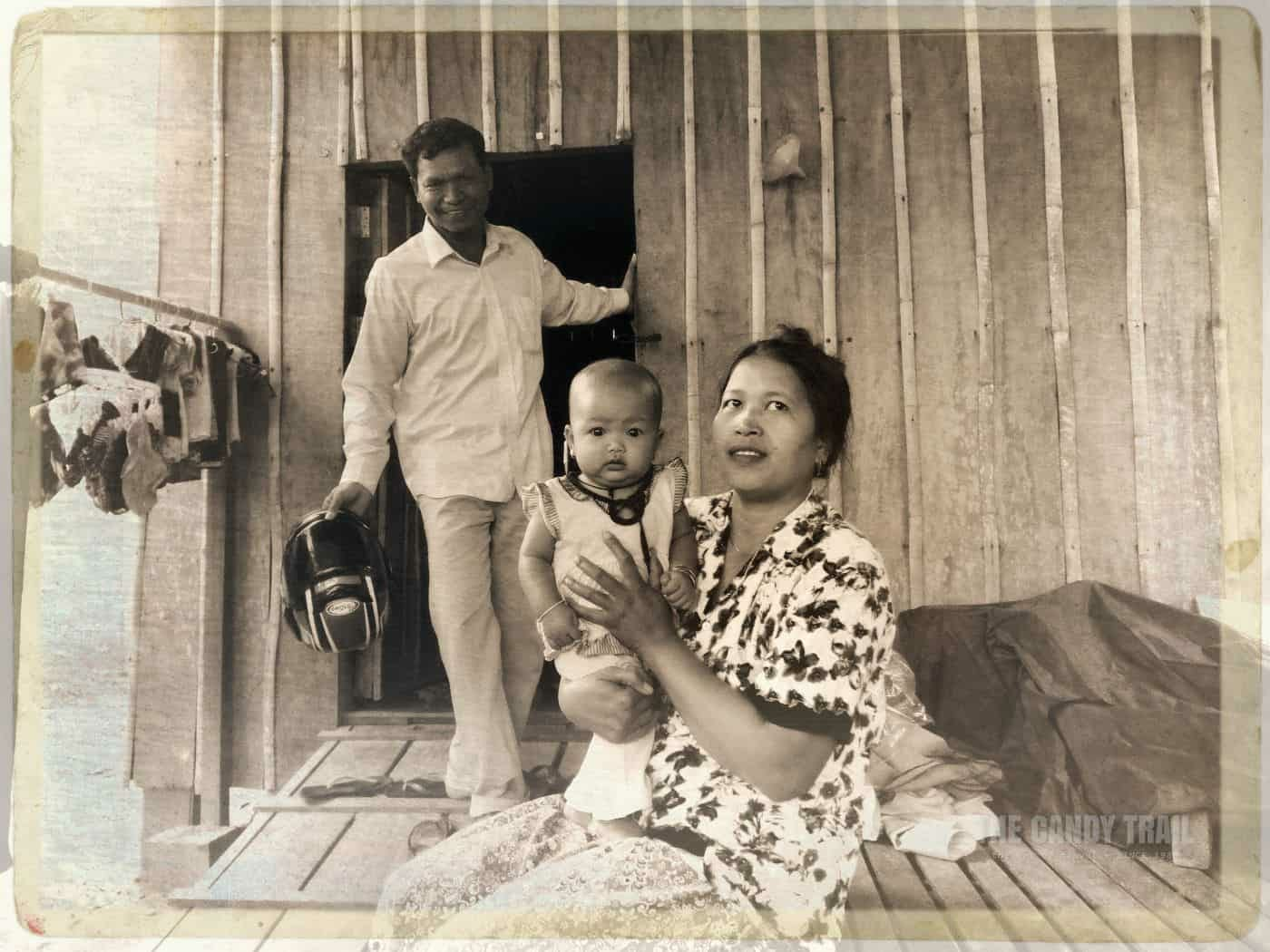 Cambodia Moto Driver At His Wooden House With Wife And Kid