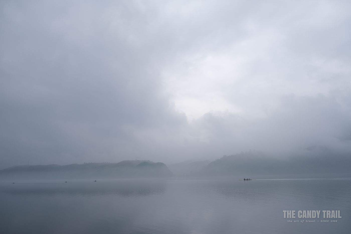 rowers on yalu river misty morning