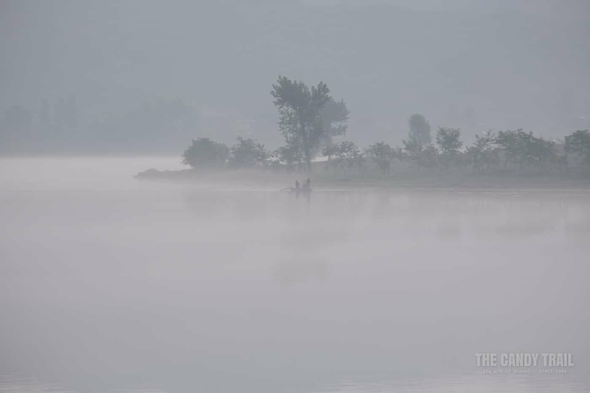 Fishermen In Boat On Yalu River North Korea Side