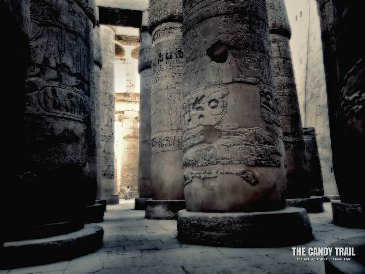 Man Amid Huge Columns Of Karnak Temple In Luxor Egypt