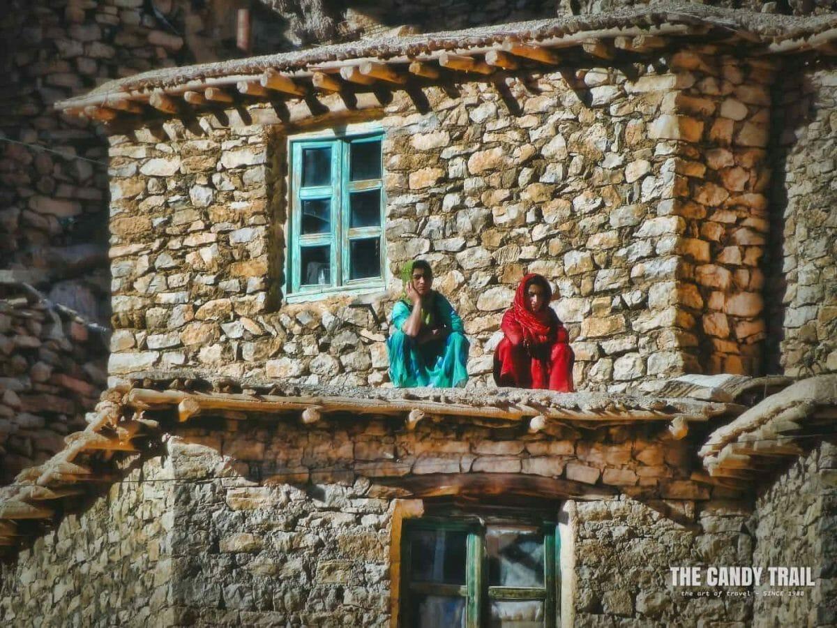 women on roof of palangan village iran
