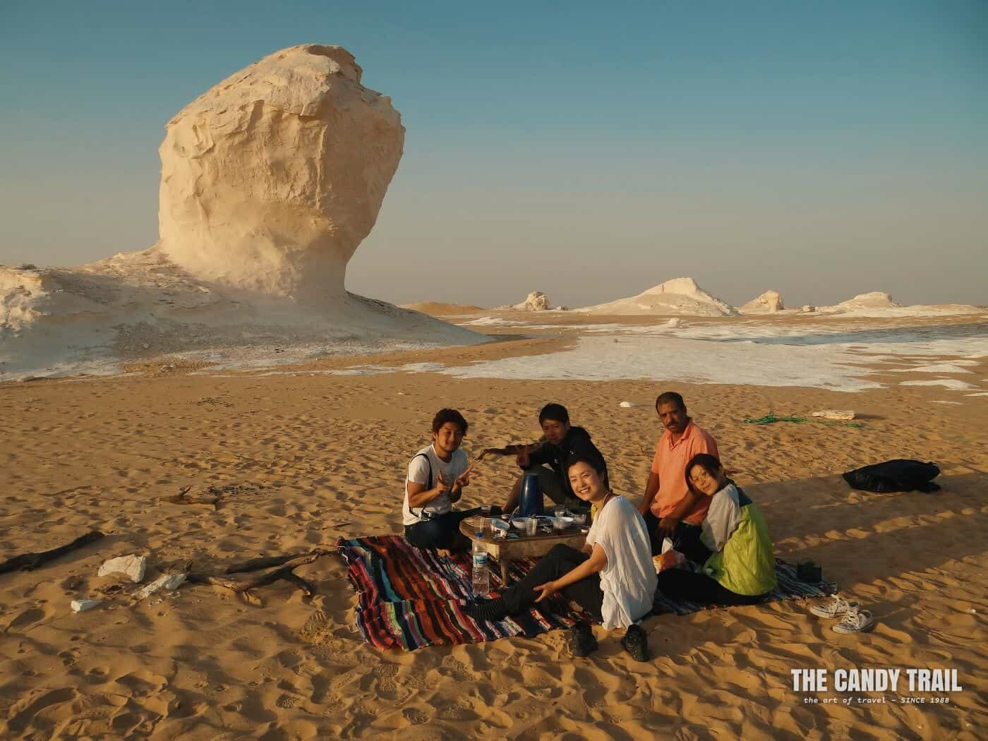 backpackers tour group camped in white desert in egypt