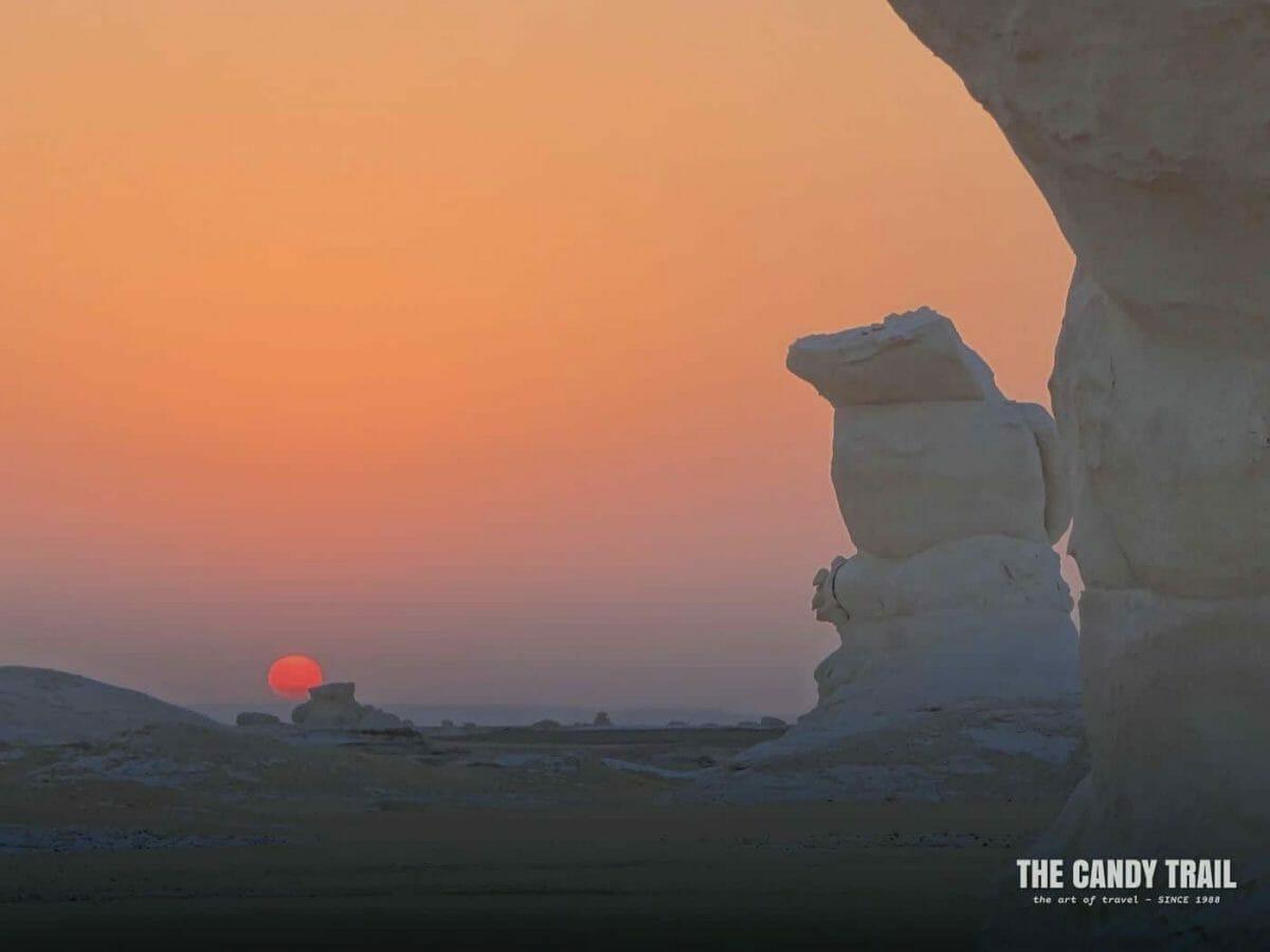 strange formations at sunrise on a white desert tour in egypt