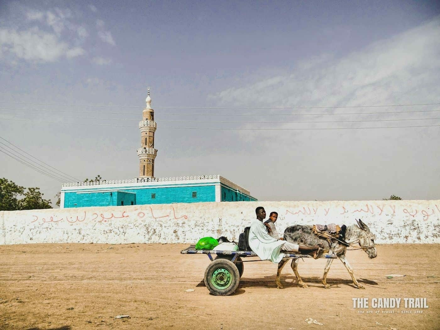 Donkey cart passing the Kerma mosque in sudan