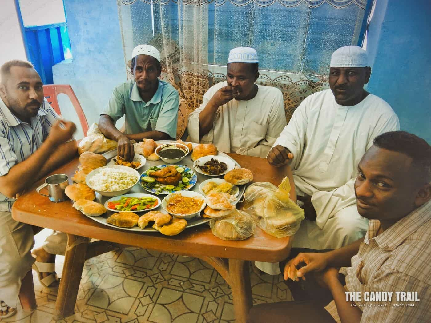 men at wedding reception meal in  dongola sudan