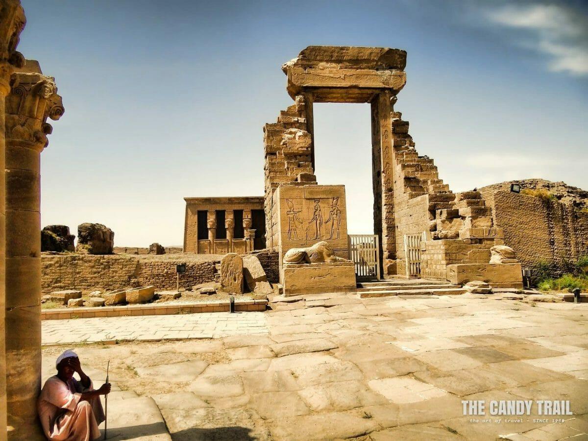 Site guardian shading at the Temple of Hathor at Dendera at searing summer's day