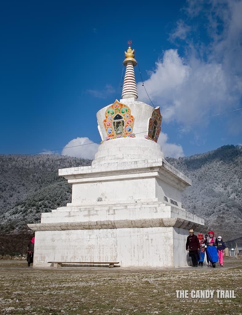 Tibetan village chorten at Shangri-La lake in mountains of Yunnan
