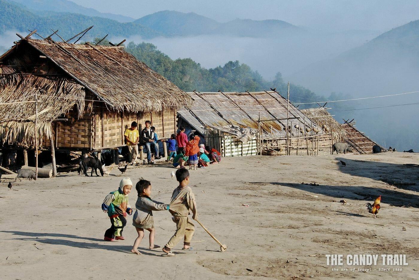 kids playing akha tribe village laos