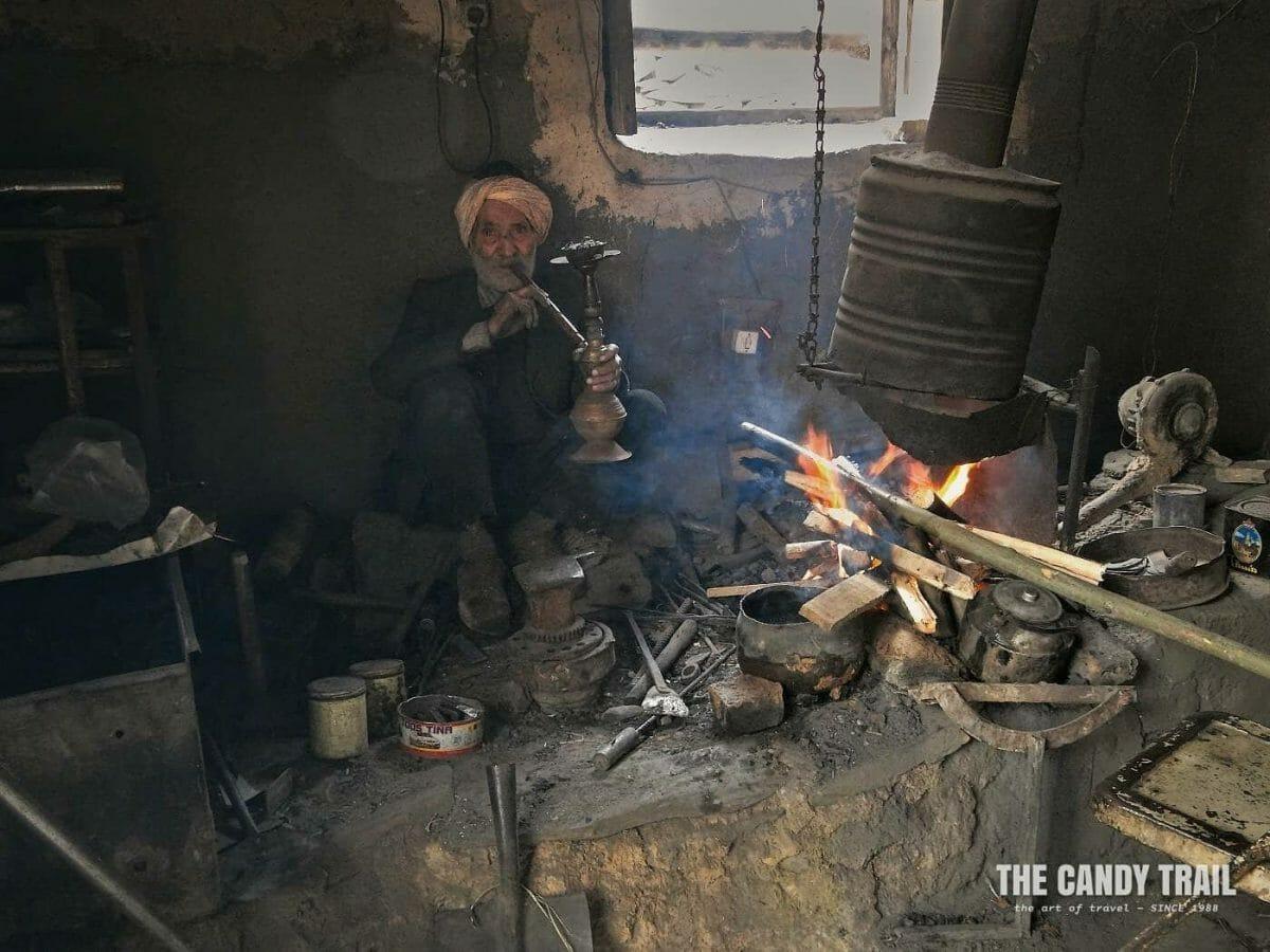 blacksmith smoking water pipe kang village iran